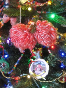My pompons, a colored glass chain, a bead chain Greg and the girls made, and an ornament Kathryn made in preschool.