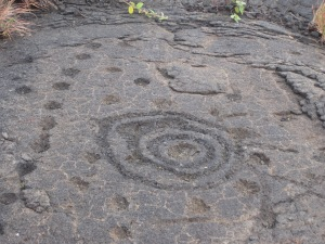 Petroglyphs - many small holes where the ancient Hawaiians place their child's umbilical cord.