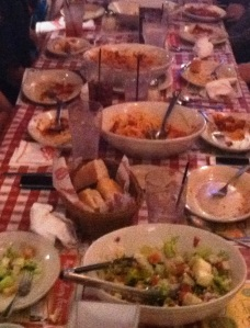 clean plates and left-over food at Buca de Beppo