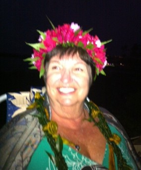 Dianne with lei crown at Talk Story