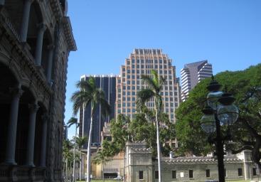 Iolani Palace dwarfed by modern Honolulu buildings