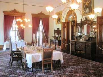 Iolani Palace dining room. Notice large chair for King.