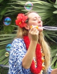 Mary blowing bubbles
