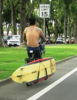 Waikiki - bike carries surfboard