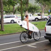 Waikiki - bike hand carry surfboard