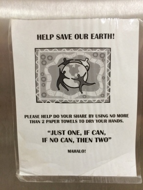 Sign on paper towel dispenser