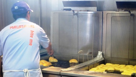 frying the malasada cropped