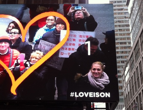 Bill board in Times Square. Daughter is inside the heart, but I am not. A metaphor?