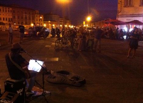 street musician playing Bob Dylan