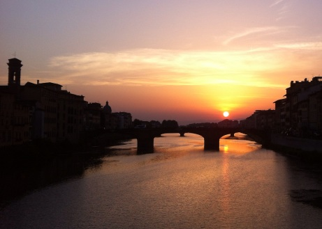Sun setting over the Arno River in Florence