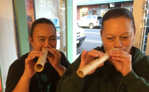 Dee and Iris trying bamboo nose flutes